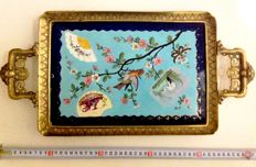 Beautifully decorated porcelaine tile, framed with bronze