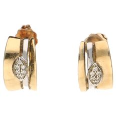 14 kt bi-colour gold ear studs, set with in total 12 brilliant cut diamonds, 0.12 ct in total.