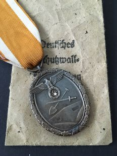 German defensive wall badge of honour in bestowal bag