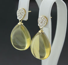 A pair of yellow citrine diamond earrings. 35.10 ct, 585 yellow gold --No reserve price--