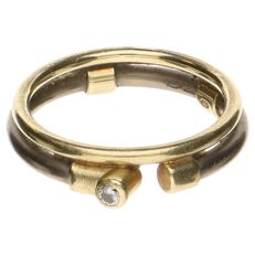 14 kt metal and yellow gold ring set with a brilliant cut diamond of 0.03 ct