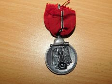 "Original Medal ""Winter Battle in the East"" with ribbon section, Wehrmacht, WW2"