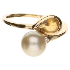 14 kt yellow gold wavy ring set with a cultured pearl, a citrine and a diamond of approx. 0.03 ct