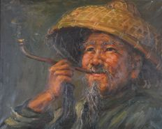 Unknown. (20th century) - A portrait of a Chinese man smoking a long pipe.