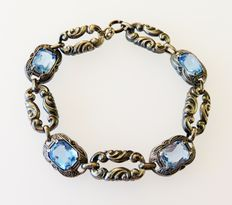 Silver 835 bracelet with 4 blue topaz gems, circa 1930