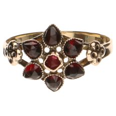 Yellow golden ring with garnets