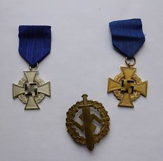 WWII A few German Awards, namely S.A. Sports-Abzeichen in bronze, 2 x Treuedienst Abzeichen 1 x 2nd Stufe in silver and 1 x 1st Stufe in gold