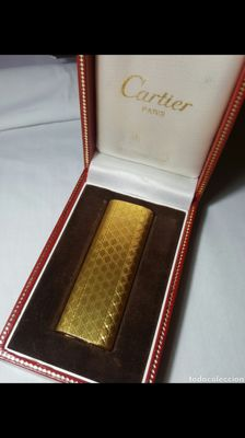 Gold plated Cartier lighter, from the 80s