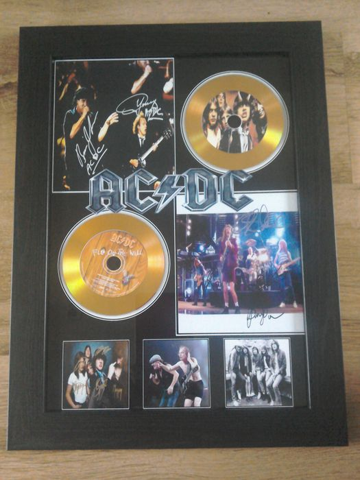 AC/DC framed gold effect cd display , complete with signed ( printed ) pictures.