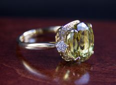7.82 ct. apatite gold ring with diamonds sides 0.45 ct.