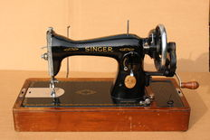 Antique Singer hand sewing machine with its original wooden case, Canada, ca.1940