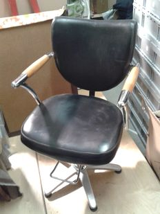 Four barber's chairs
