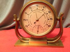 Old barometer and thermometer in brass