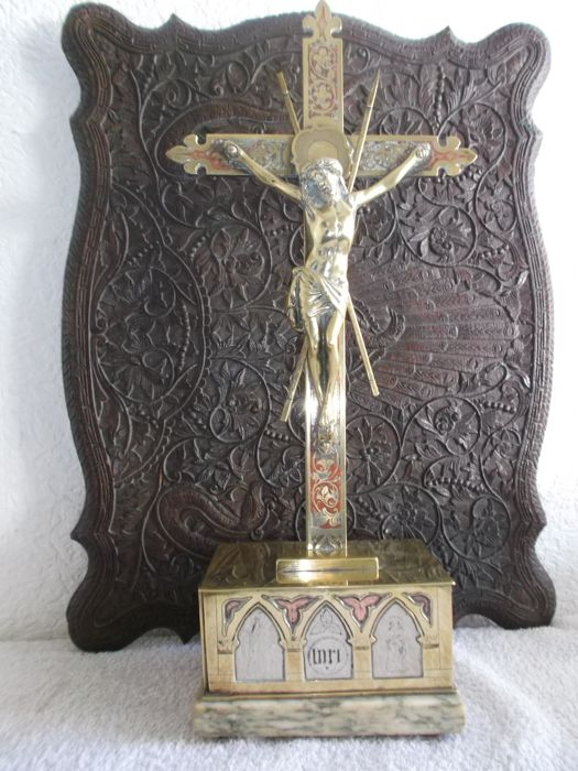 Brass altar cross decorated with symbols and silver.