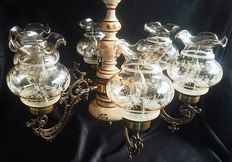 Brass chandelier with ceramic parts together with six cut glass trumpet forms for the lights