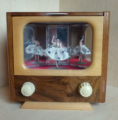 Music box with dancer and storage space for cigarettes