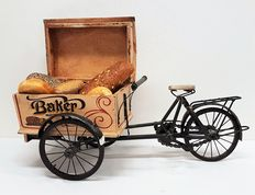 Large, antique baker's bicycle.