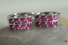 White gold earrings with rubies