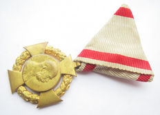 Austria Franz Josef medal 1908 to original triangular ribbon with push button.