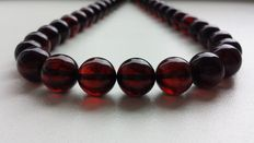Vintage Baltic amber necklace, dark cherry beads, 37 grams
