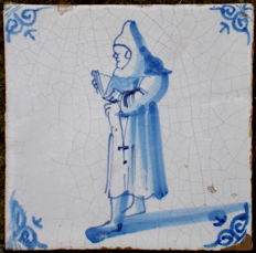 Rare antique tile with monk, 17th century.