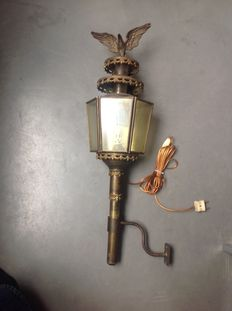 Large antique brass carriage lamp with eagle on top. Approx. 1920, the Netherlands