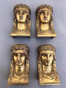 Four finely detailed bronze Empire style ornaments - France - early 20th century