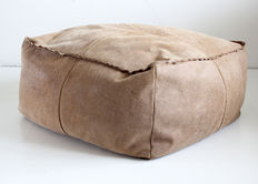 Designer unknown - large roughened leather ottoman
