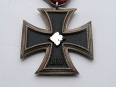 Original iron cross created by JJ Stahl marked 122 on the original ribbon