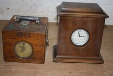 Two pigeon clocks made in Belgium, 1 x in wood Gebr. Plasschaert. and 1 x in metal Gebr. De Scheemaecker, with unique wooden box