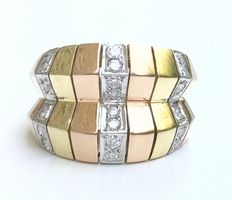 Sumptuous tricolour band ring in 18 kt Gold decorated with lines of extra-white diamonds.
