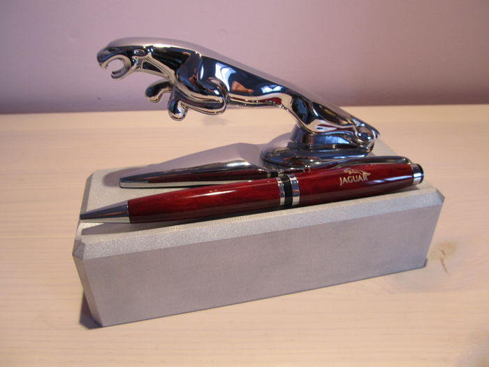 Jaguar - Hood ornament, emblem on a base with a pen .