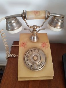 Stylish vintage telephone from the 1960s in yellow Onyx (honey) with floral decorations and brass
