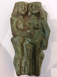 Green-brown glazed earthenware plaque of a male and female nude man and lady in cubist style.