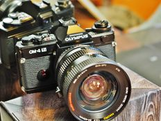 Olympus OM-4 ti black with very fine 24-40 wide-angle zoom and record data back