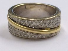 18 kt solid gold ring with in total 0.60 ct in diamonds, ring size 17 mm