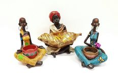 Three sitting blackamoors with bowls -  France - 20th century.