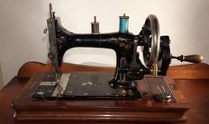 Antique working Victoria hand sewing machine with the original wooden box, approx. 1900