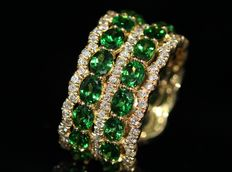 18 kt gold eternity ring set with natural tsavorite garnet and diamonds.