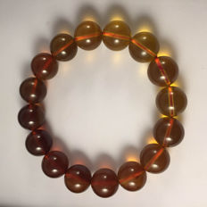 Myanmar amber gradient colour bracelet, weight 15.2 grams.