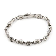 White gold solid bracelet, set with brilliant-cut diamonds, with box tongue clasp.