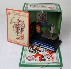 Actual working children's sewing machine - Singer box and manual, Mid-20th century