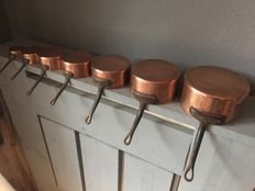 Seven-piece copper saucepans, France, 2nd half of 20th century