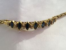 18 kt gold bracelet with seven sapphires and 16 diamonds, length:  16 cm.