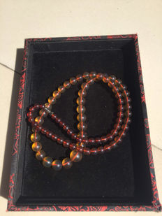 Myanmar amber gradient necklace weight 24.1 grams. incl. certificate of the Peking University Gem appraisal Center