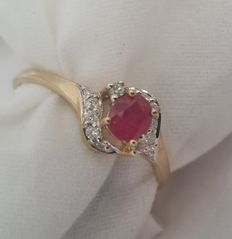 A 9 ct yellow gold ruby and diamond cluster ring