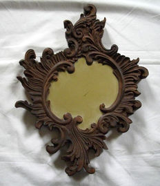 Mirror with carved wooden frame