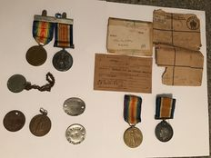 Estate clearance collection of war medals papers coin British war victory tags