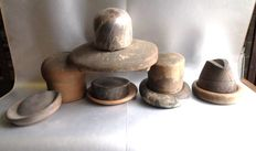 Ten wooden hat moulds, England, early 20th century
