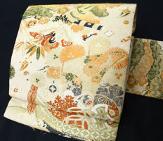 Silk Nagoya Obi surrounded by classic japanese designs of crane - Japan - late 20th century